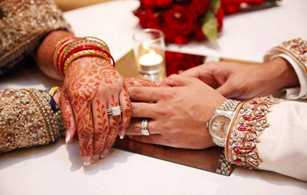 Asian wedding: husband and wife hands